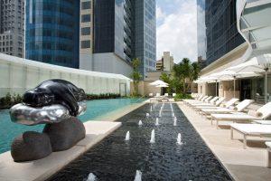 Serene poolside view of St. Regis Hotel