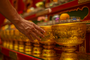 Praying inside Buddhist Temple in Singapore