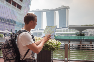 Tourist with Singapore map