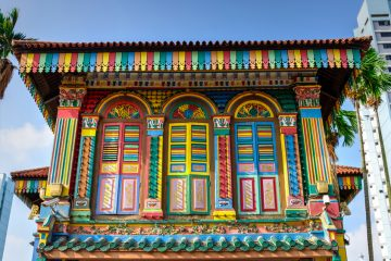Colorful facade of building with clear blue sky in Little India, Singapore