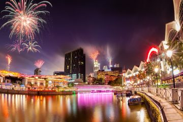Fireworks set off in the backdrop to the Singapore River along Clarke Quay